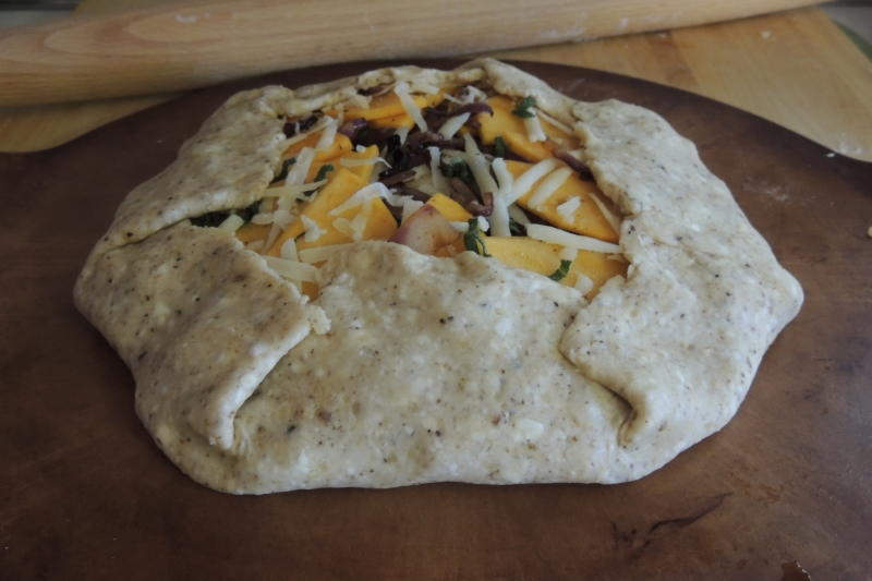 Gently fold up the outer edge of the dough around the filling to look like this!