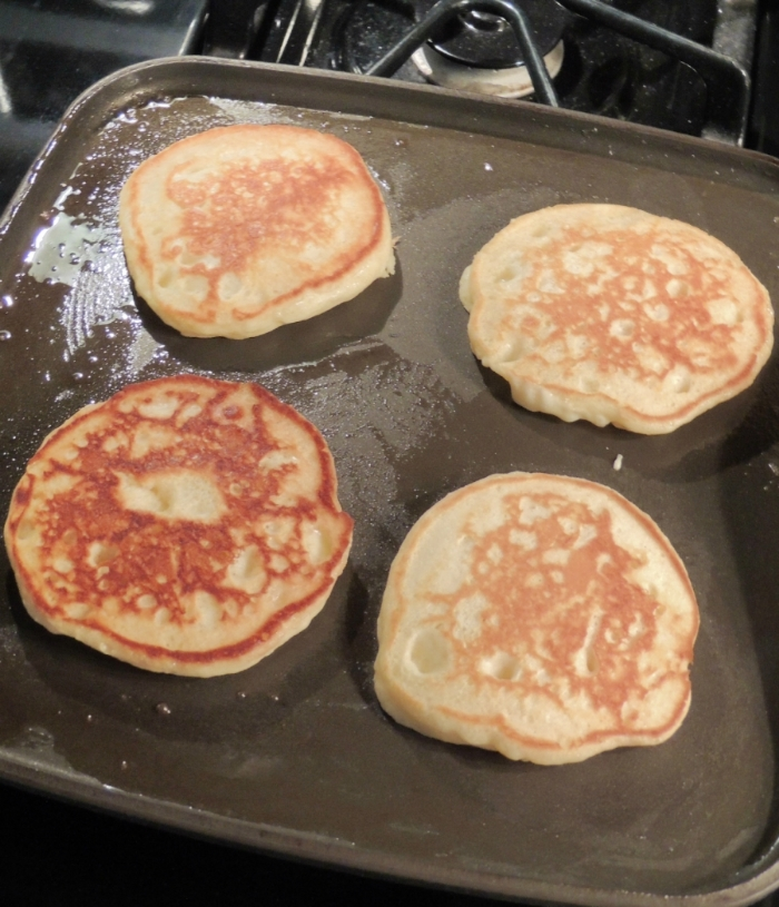 If you want the pancakes to have a more uniform color, after you melt the butter gently wipe the griddle with a paper towel until you don't see anymore butter. That will allow for more even browning, while still having a nonstick surface.