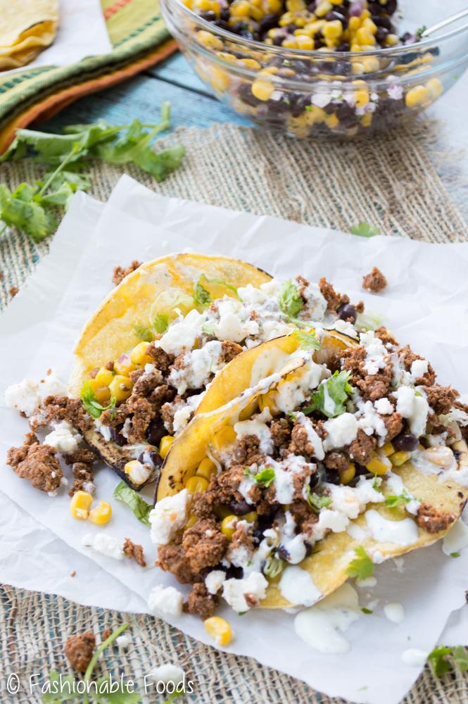 Chorizo Tacos with Black Bean Corn Salsa and Cilantro Lime Crema