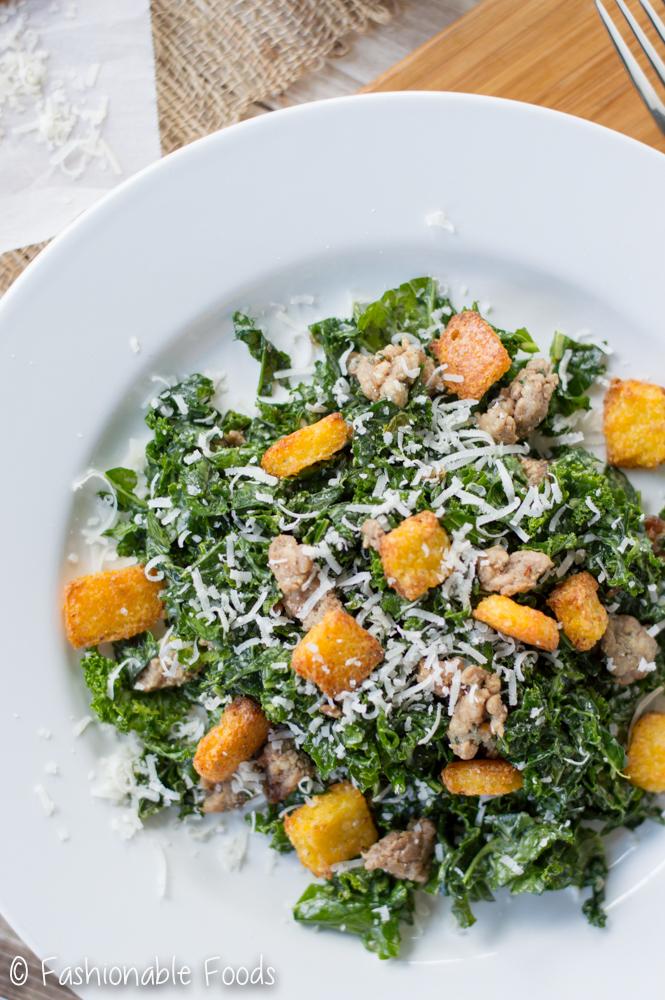 kale-caesar-salad-with-polenta-croutons-and-sausage