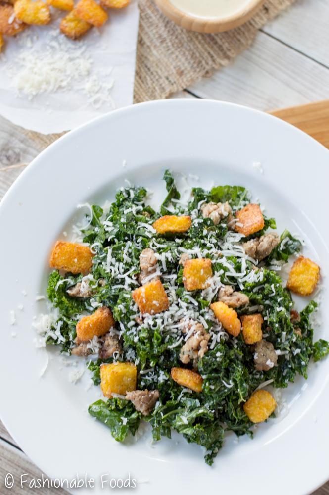 kale-caesar-salad-with-sausage-and-polenta-croutons_