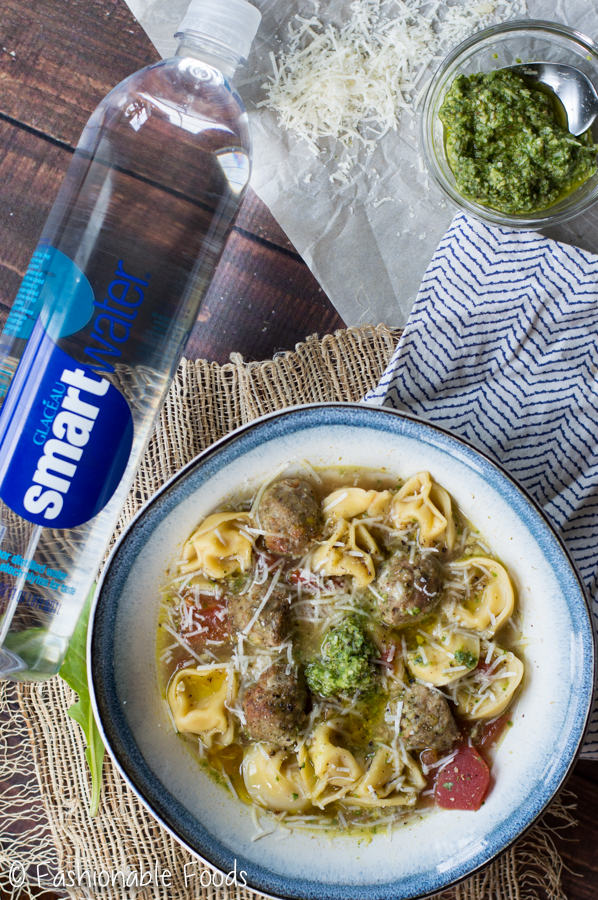 Tortellini And Chicken Meatball Soup With Walnut Arugula Pesto